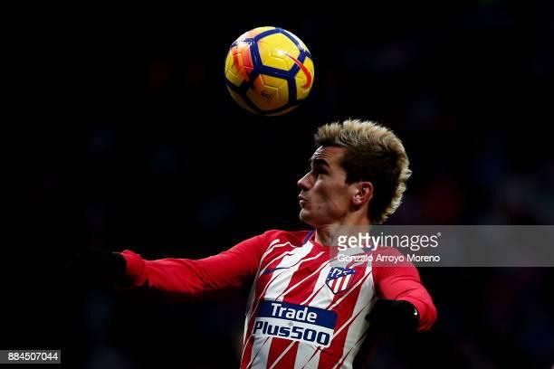 Antoine Griezmann of Atletico de Madrid saves on a header during the La Liga match between Club Atletico Madrid and Real Sociedad de Futbol at...