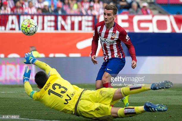 Antoine Griezmann of Atletico de Madrid scores their fourth goal during the La Liga match between Club Atletico de Madrid and Real Betis Balompie at...