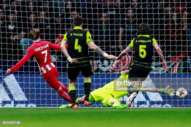 Antoine Griezmann of Atletico de Madrid scores their second goal during the UEFA Europa League quarter final leg one match between Club Atletico...
