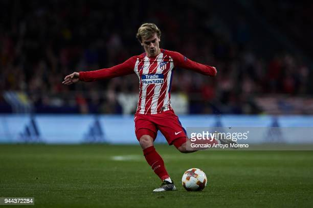 Antoine Griezmann of Atletico de Madrid strikes the ball during the UEFA Europa League quarter final leg one match between Club Atletico Madrid and...