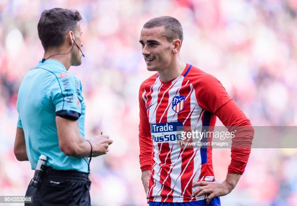 Antoine Griezmann of Atletico de Madrid talks with referee Jesus Gil Manzano during the La Liga 201718 match between Atletico de Madrid and Levante...