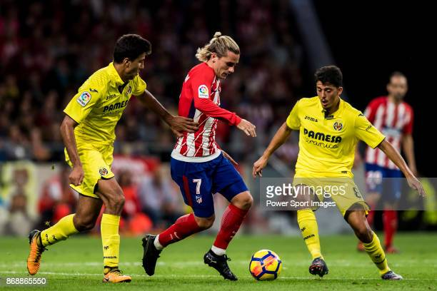 Antoine Griezmann of Atletico de Madrid vies for the ball with Rodrigo Hernandez Cascante Rodri and Pablo Fornals of Villarreal CF during the La Liga...