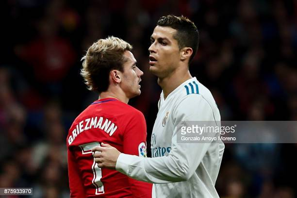 Antoine Griezmann of Atletico de Madrid walks behind Cristiano Ronaldo of Real Madrid CF during the La Liga match between Club Atletico Madrid and...