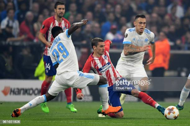 Antoine Griezmann of Atletico Madrid and AndreFrank Zambo Anguissa of Olympique Marseille compete for the ball during the UEFA Europa League Final...
