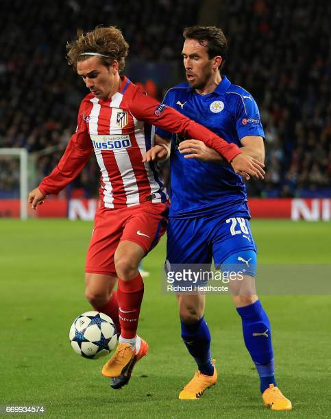Antoine Griezmann of Atletico Madrid and Christian Fuchs of Leicester City battle for possession during the UEFA Champions League Quarter Final...