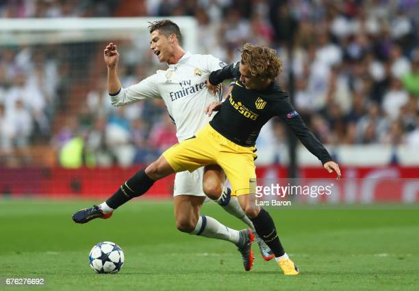 Antoine Griezmann of Atletico Madrid and Cristiano Ronaldo of Real Madrid battle for the ball during the UEFA Champions League semi final first leg...