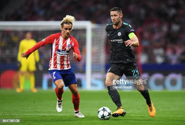 Antoine Griezmann of Atletico Madrid and Gary Cahill of Chelsea in action during the UEFA Champions League group C match between Atletico Madrid and...