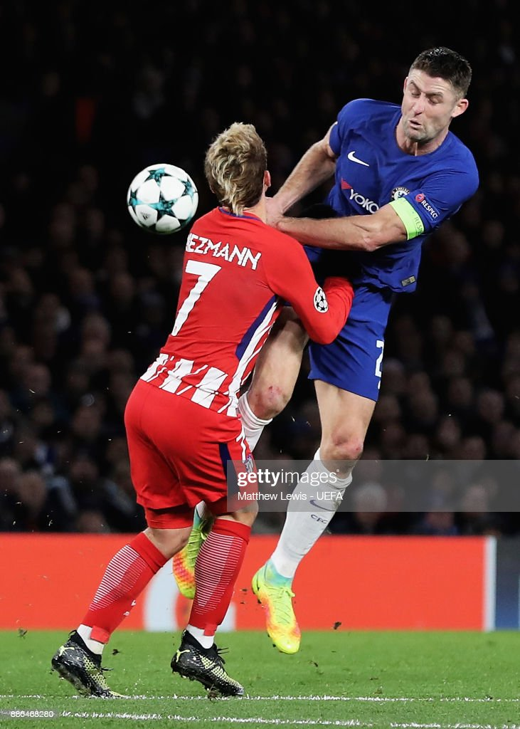 Antoine Griezmann of Atletico Madrid and Gary Cahill of Chelsea during the UEFA Champions League group C match between Chelsea FC and Atletico Madrid at Stamford Bridge on December 5, 2017 in London, United Kingdom.