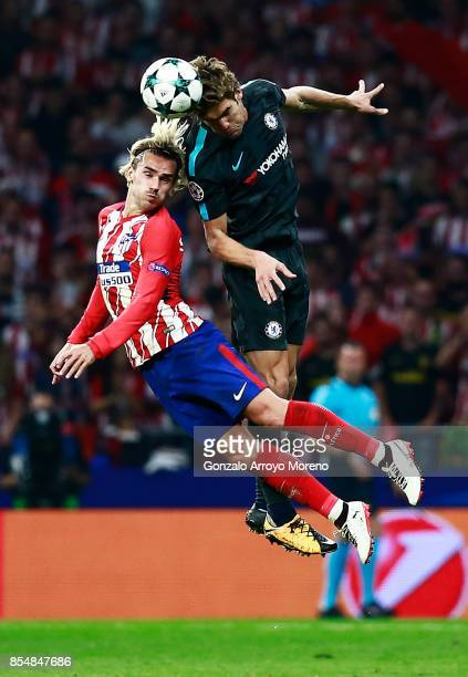 Antoine Griezmann of Atletico Madrid and Marcos Alonso of Chelsea in action during the UEFA Champions League group C match between Atletico Madrid...