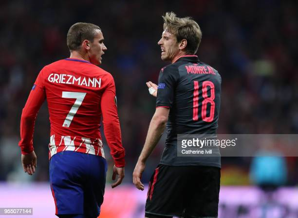 Antoine Griezmann of Atletico Madrid and Nacho Monreal of Arsenal during the UEFA Europa League Semi Final second leg match between Atletico Madrid...