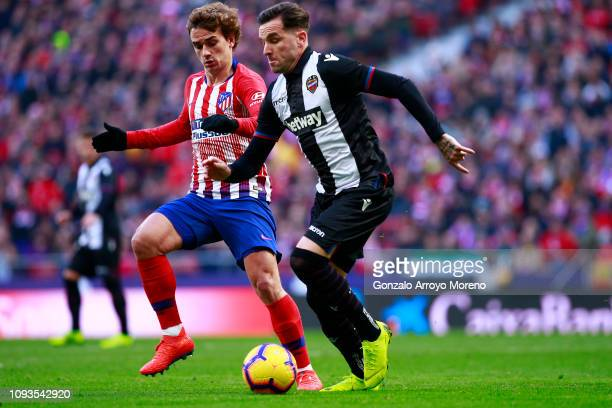 Antoine Griezmann of Atletico Madrid battles for possession with Tono Garcia of Levante during the La Liga match between Club Atletico de Madrid and...
