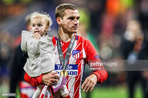 Antoine Griezmann of Atletico Madrid carries his daughter after the UEFA Europa League Final between Olympique de Marseille and Club Atletico de...