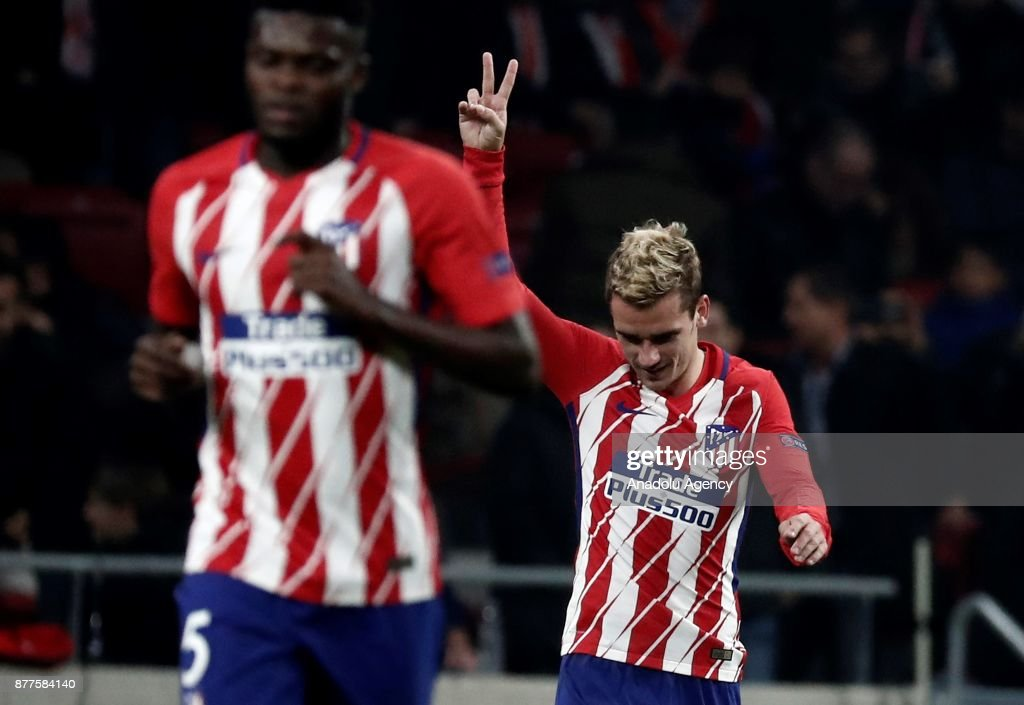 Antoine Griezmann (R) of Atletico Madrid celebrates after scoring a goal during UEFA Champions League Group C soccer match between Atletico Madrid and AS Roma at Wanda Metropolitano Stadium in Madrid, Spain on November 22, 2017.