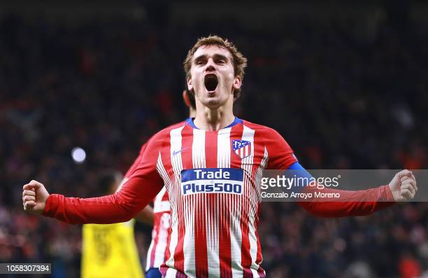 Antoine Griezmann of Atletico Madrid celebrates after scoring his team's second goal during the Group A match of the UEFA Champions League between...