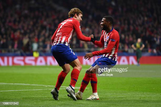 Antoine Griezmann of Atletico Madrid celebrates after scoring his team's second goal with Thomas Lemar of Atletico Madrid during the UEFA Champions...