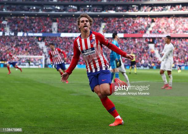 Antoine Griezmann of Atletico Madrid celebrates after scoring his team's first goal during the La Liga match between Club Atletico de Madrid and Real...