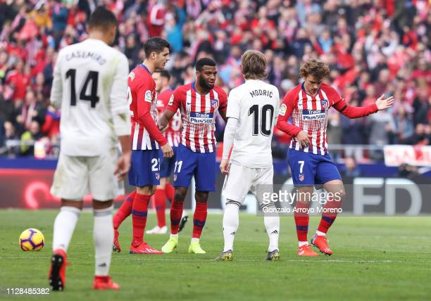 Antoine Griezmann of Atletico Madrid celebrates after scoring his team's first goal in front of Luka Modric of Real Madrid during the La Liga match...