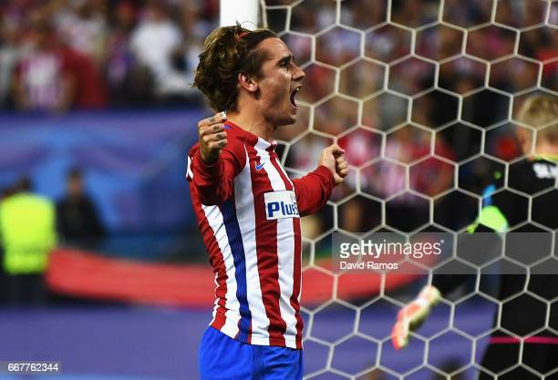 Antoine Griezmann of Atletico Madrid celebrates after scoring his team's first goal of the game from the penalty spot during the UEFA Champions...