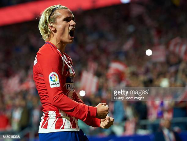 Antoine Griezmann of Atletico Madrid celebrates after scoring the first goal during the La Liga match between Atletico Madrid and Malaga at Wanda...