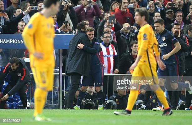 Antoine Griezmann of Atletico Madrid celebrates his second goal with coach of Atletico Madrid Diego Simeone during the UEFA Champions League quarter...