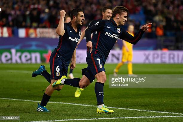 Antoine Griezmann of Atletico Madrid celebrates scoring his penalty with Koke for his team's second goal during the UEFA Champions League quarter...