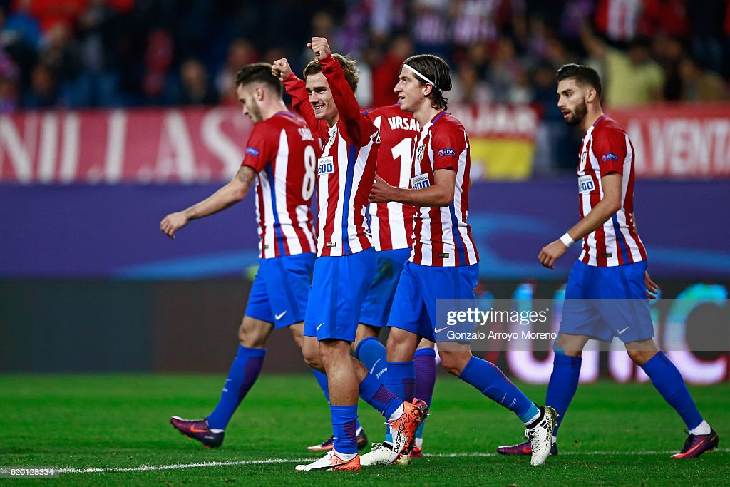 Antoine Griezmann of Atletico Madrid (C) celebrates scoring his sides first goal during the UEFA Champions League Group D match between Club Atletico de Madrid and FC Rostov at Vincente Calderon on November 1, 2016 in Madrid, Spain.
