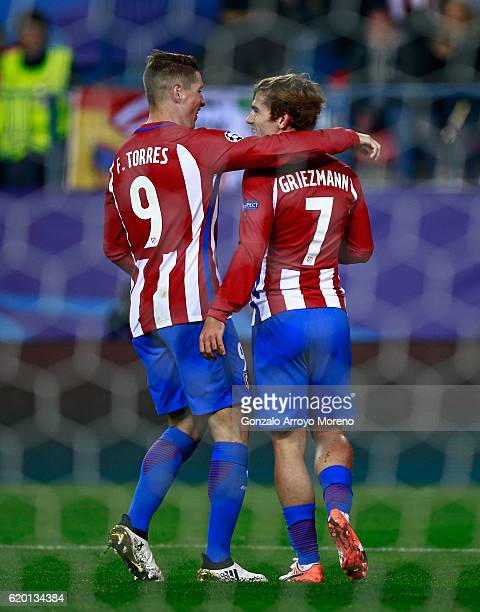 Antoine Griezmann of Atletico Madrid celebrates scoring his sides second goal with Fernando Torres of Atletico Madrid during the UEFA Champions...