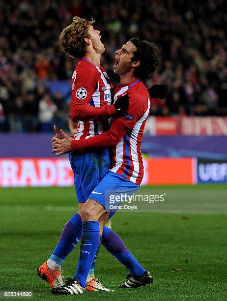 Antoine Griezmann of Atletico Madrid celebrates scoring his sides second goal with Tiago of Atletico Madrid during the UEFA Champions League Group D...