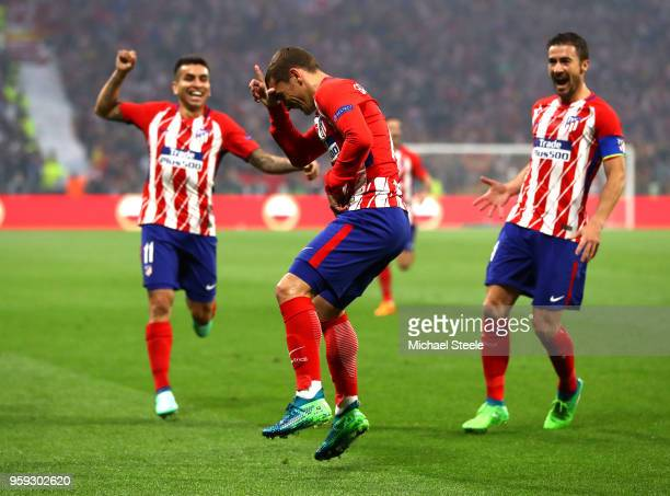 Antoine Griezmann of Atletico Madrid celebrates scoring the opening goal of the game during the UEFA Europa League Final between Olympique de...