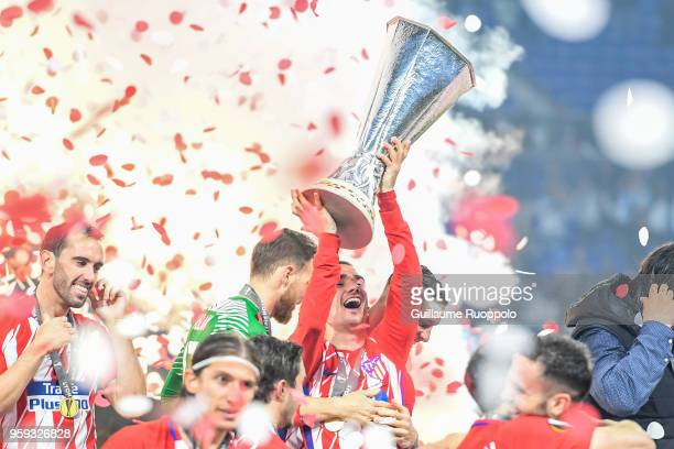 Antoine Griezmann of Atletico Madrid celebrates the victory with the trophy during the Europa League Final match between Marseille and Atletico...