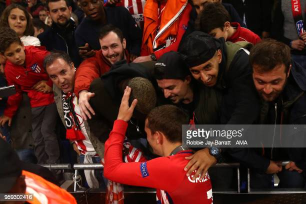 Antoine Griezmann of Atletico Madrid celebrates with fans at the end of the UEFA Europa League Final between Olympique de Marseille and Club Atletico...