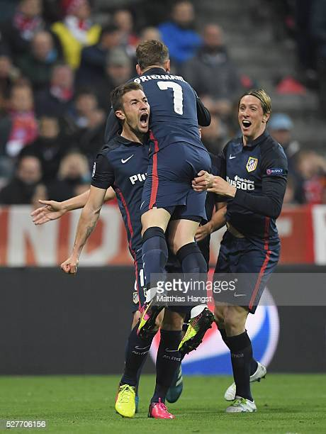 Antoine Griezmann of Atletico Madrid celebrates with Gabi and Fernando Torres as he scores their first goal during UEFA Champions League semi final...