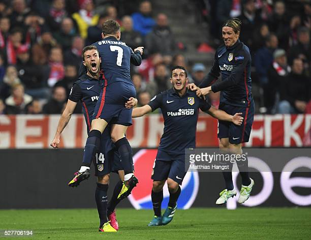 Antoine Griezmann of Atletico Madrid celebrates with Gabi Koke and Fernando Torres as he scores their first goal during UEFA Champions League semi...
