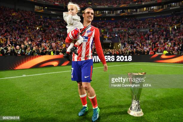 Antoine Griezmann of Atletico Madrid celebrates with his daughter after winning the UEFA Europa League Final between Olympique de Marseille and Club...