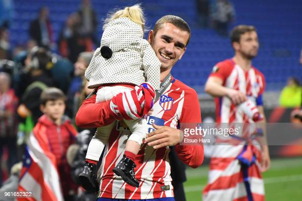 Antoine Griezmann of Atletico Madrid celebrates with his daughter after the UEFA Europa League Final between Olympique de Marseille and Club Atletico...