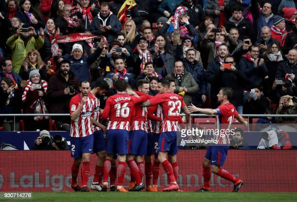Antoine Griezmann of Atletico Madrid celebrates with his team mates after scoring a goal during the La Liga soccer match between Atletico Madrid and...