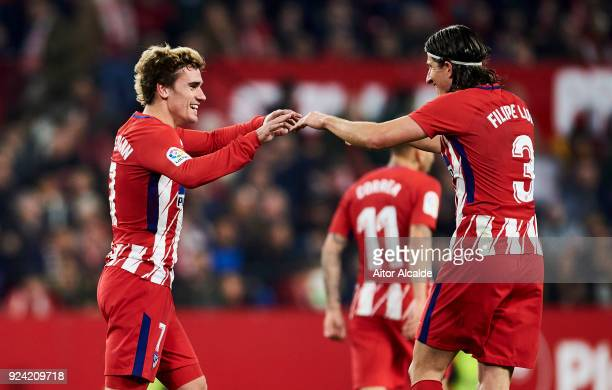 Antoine Griezmann of Atletico Madrid celebrates with his teammates Filipe Luis of Atletico Madrid after scoring his team's fifth goal during the La...