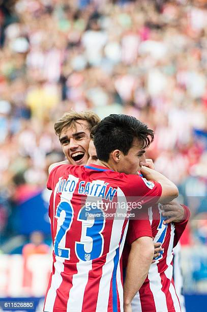 Antoine Griezmann of Atletico Madrid celebrates with Nicolas Gaitan and Kevin Gameiro during their La Liga match between Atletico Madrid and...