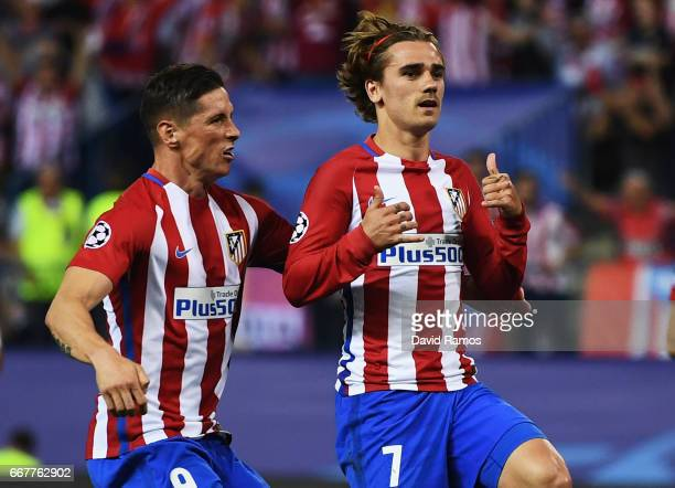 Antoine Griezmann of Atletico Madrid celebrates with team mate Fernando Torres after scoring the opening goal of the game during the UEFA Champions...