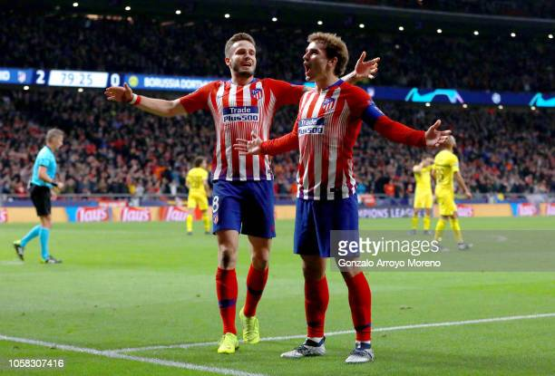 Antoine Griezmann of Atletico Madrid celebrates with team mate Saul Niguez after scoring their team's second goal during the Group A match of the...