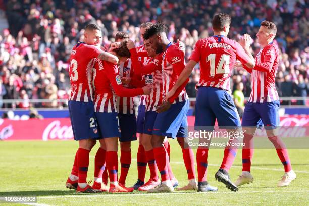 Antoine Griezmann of Atletico Madrid celebrates with teammates after scoring his team's first goal from the penalty spot during the La Liga match...