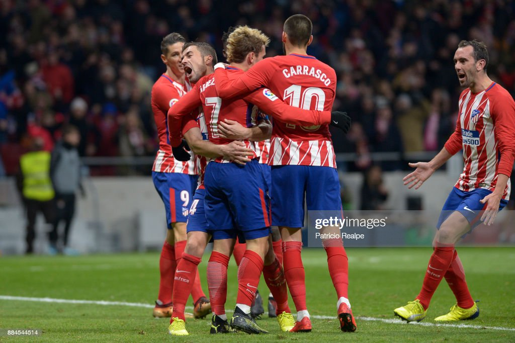 Antoine Griezmann of Atletico Madrid celebrates with teammates after scoring the second goal of his team during a match between Atletico Madrid and Real Sociedad as part of La Liga at Wanda Metropolitano Stadium on December 02, 2017 in Madrid, Spain.