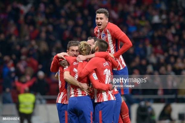 Antoine Griezmann of Atletico Madrid celebrates with teammates after scoring the second goal of his team during a match between Atletico Madrid and...