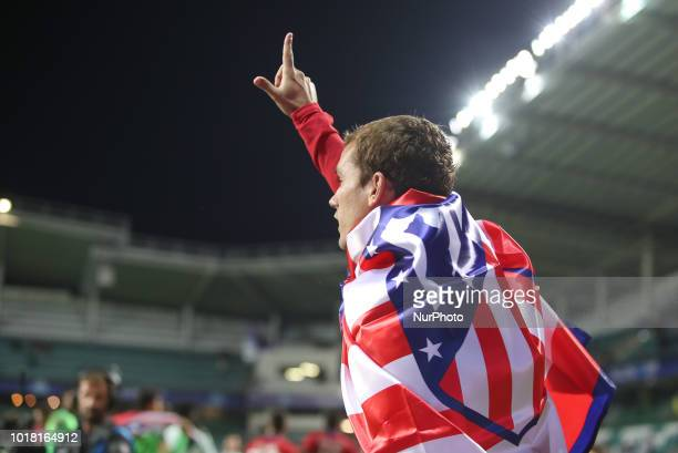 Antoine Griezmann of Atletico Madrid celebrates with the flag following the UEFA Super Cup between Real Madrid and Atletico Madrid at Lillekula...