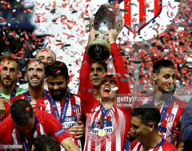 Antoine Griezmann of Atletico Madrid celebrates with the trophy after the UEFA Super Cup match between Real Madrid and Atletico Madrid at Lillekula...