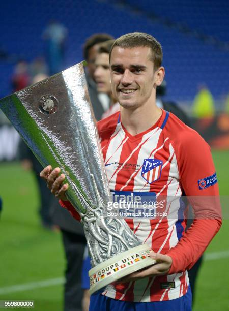 Antoine Griezmann of Atletico Madrid celebrates with the trophy after the UEFA Europa League Final between Olympique de Marseille and Club Atletico...