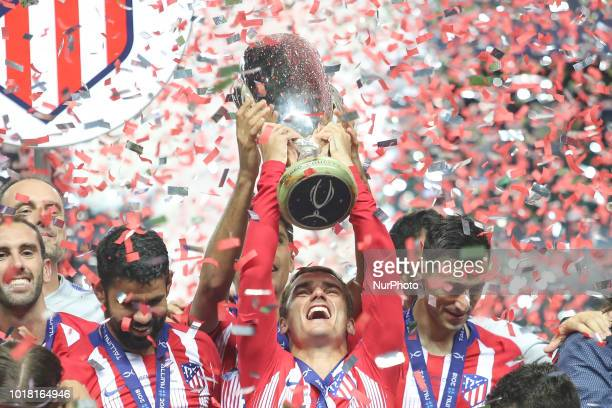 Antoine Griezmann of Atletico Madrid celebrates with the trophy following the UEFA Super Cup between Real Madrid and Atletico Madrid at Lillekula...