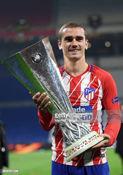 Antoine Griezmann of Atletico Madrid celebrates with the trophy following the UEFA Europa League Final between Olympique de Marseille and Club...