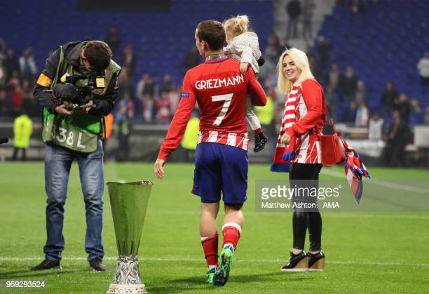 Antoine Griezmann of Atletico Madrid celebrates with wife Erika and daughter Mia at the end of the UEFA Europa League Final between Olympique de...