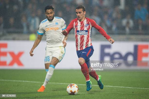 Antoine Griezmann of Atletico Madrid closes in on his second goal of the match chased by Jordan Amavi of Marseille during the UEFA Europa League...